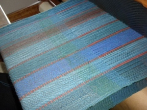photo of a woven section on the loom