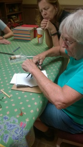 Sandy making her handmade paper notebook.