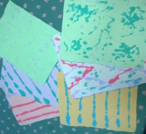 The designs on the paper were from liquidized paper, squirted on after the paper was made.