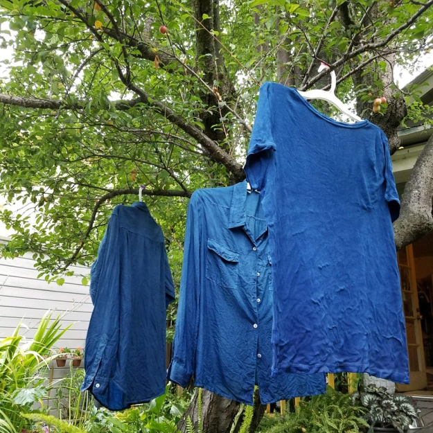 three tops dyed with indigo