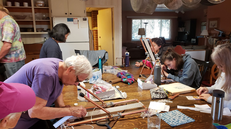members of Fiber Artisans working on their tapestry looms